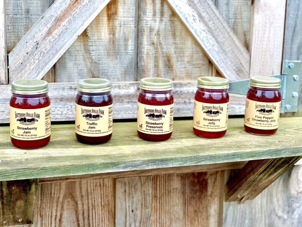 a row of jam jars on a wooden ledge