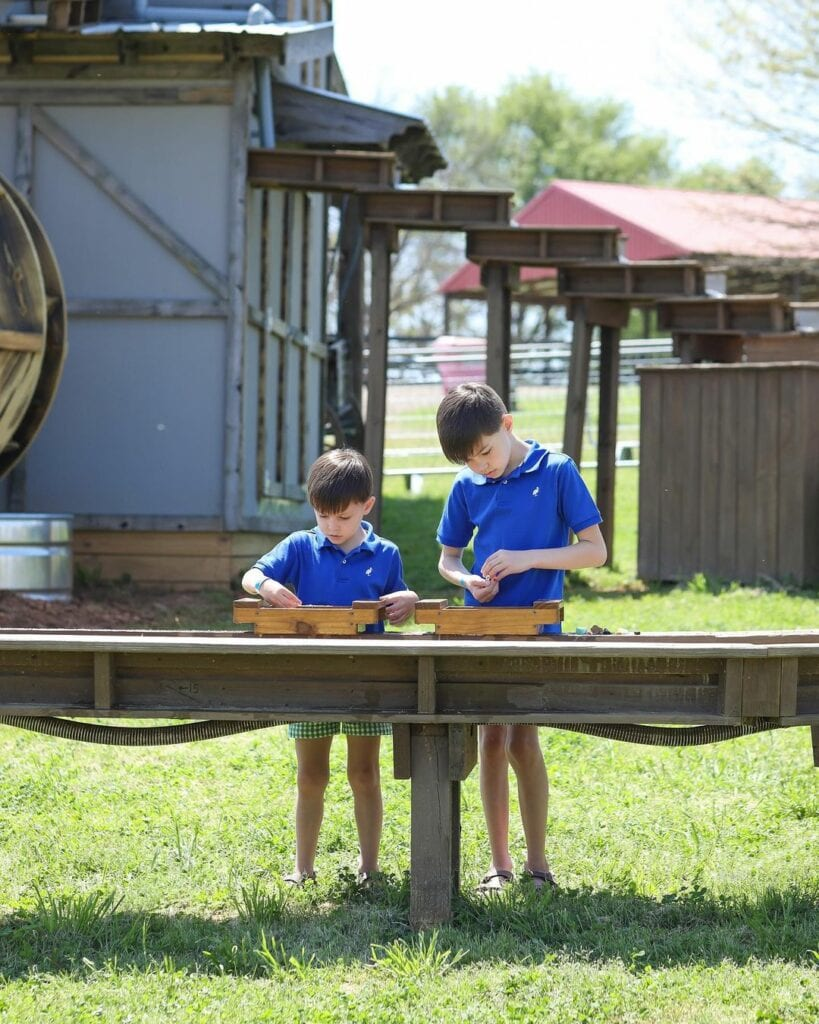 two boys playing at a gem mining activity